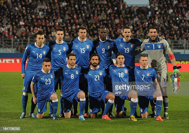 Italy's team poses before the FIFA 2014 World Cup qualifying football match Malta vsItaly at the National Stadium in Malta on March 26 2013 AFP PHOTO...