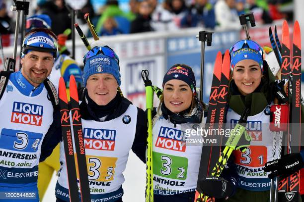 Italy's teammates Dominik Windisch Lukas Hofer Dorothea Wierer and Lisa Vittozzi pose after placing second of the IBU Biathlon World Cup 4x6 Mixed...