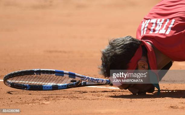 TOPSHOT Italy's tennis player Fabio Fognini celebrates after defeating 26 46 63 64 62 Argentina's Guido Pella during their 2017 Davis Cup World Group...