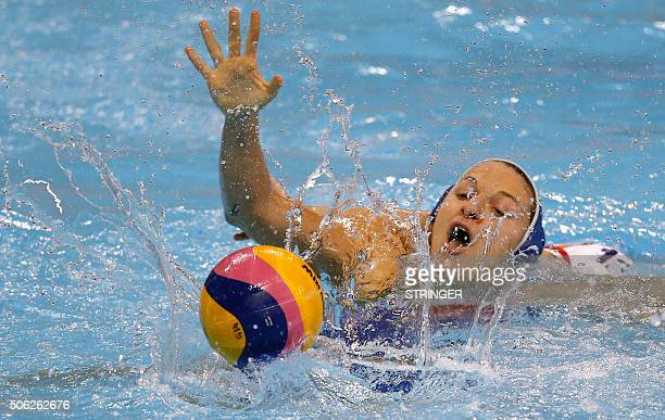 Italy's Teresa Frassinetti vies for the ball with Spain's Laura Lopez during the women's water polo bronze medal match between Spain and Italy at the...