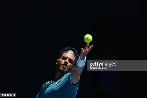 Italy's Thomas Fabbiano serves against Germany's Alexander Zverev during their men's singles first round match on day two of the Australian Open...