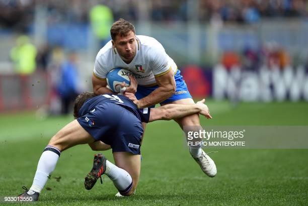 Italy's Tommaso Benvenuti is tackled by Scotland's Tim Swinson during the Six Nations international rugby union match between Italy and Scotland at...