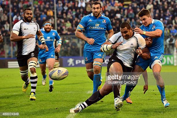 Italy's Tommaso Iannone fights for the ball with Fiji's hooker Seremaia Namaralevu during the rugby test match between Italy and Fiji on November 15...