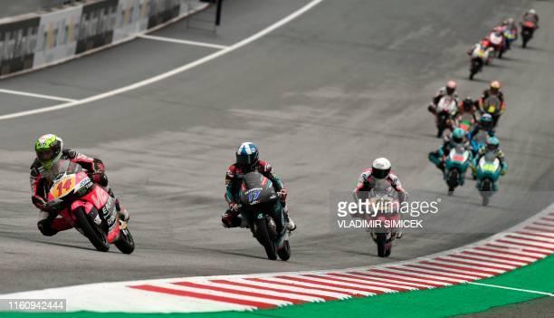 Italy's Tony Arbolino from team VNE Snipers Britain's John Mcphee from team Petronas Sprinta Racing Italy's Romano Fenati from team VNE Snipers and...
