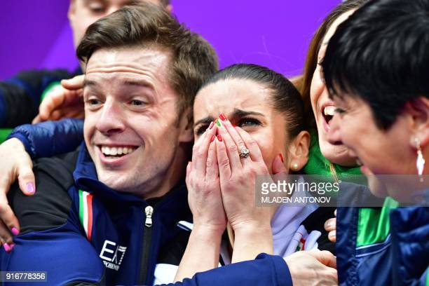Italy's Valentina Marchei and Italy's Ondrej Hotarek react after competing in the figure skating team event pair skating free skating during the...