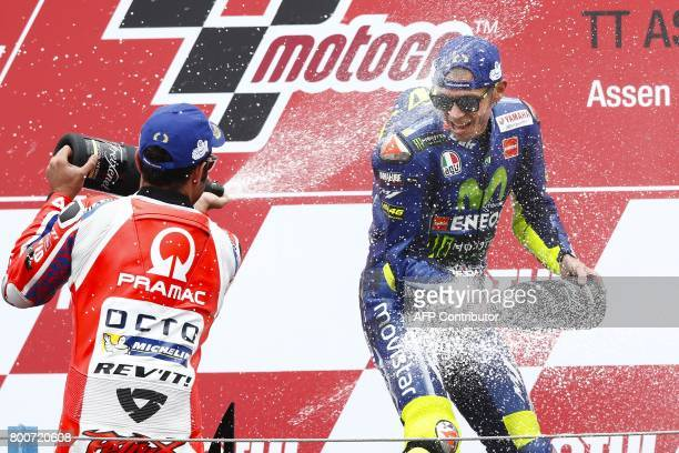 Italy's Valentino Rossi celebrates winning the MotoGP race of the Motorcycling Grand Prix of Assen at the TT circuit in Assen on June 25 2017 / AFP...