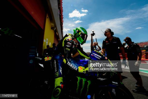 Italy's Valentino Rossi departs from the pits on his Yamaha for free practice 4 ahead the Italian Moto GP Grand Prix at the Mugello race track on...