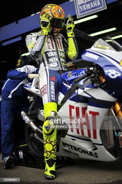 Italy's Valentino Rossi of the Fiat Yamaha team sits on his bike to get ready before the warmup of the Moto Grand Prix of Germany at the Sachsenring...