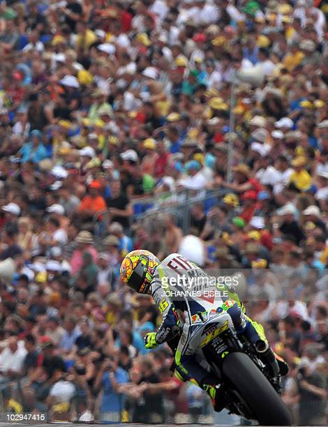 Italy's Valentino Rossi of the Fiat Yamaha team steers his bike during the qualifying practice of the MotoGP race at the Sachsenring Circuit on July...