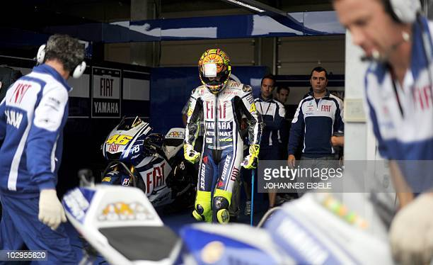 Italy's Valentino Rossi of the Fiat Yamaha team walks on crutches towards his bike to get ready before the warmup of the Moto Grand Prix of Germany...