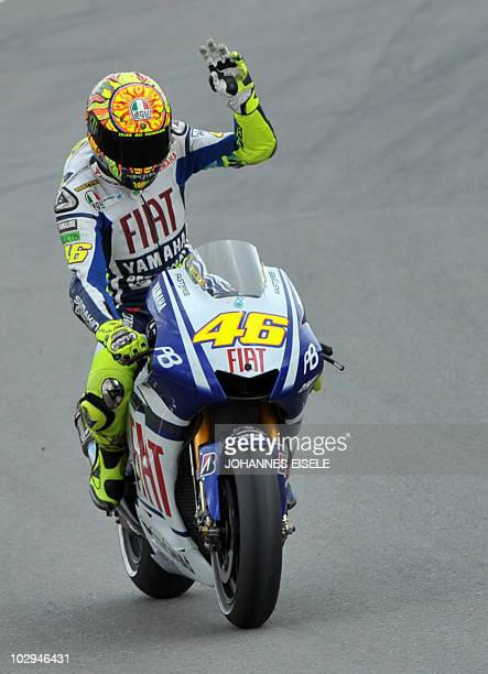 Italy's Valentino Rossi of the Fiat Yamaha team waves on his bike during the qualifying practice of the MotoGP race at the Sachsenring Circuit on...
