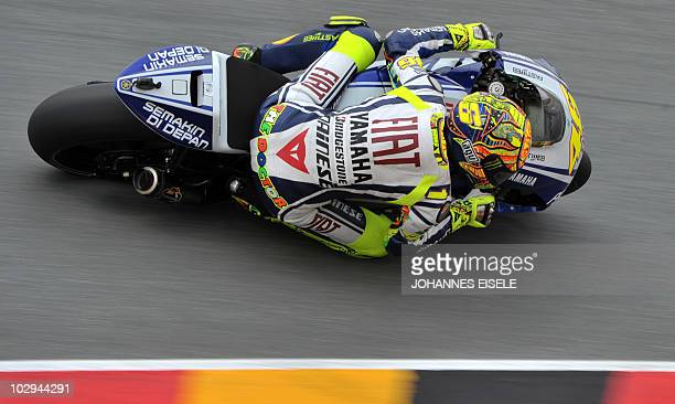 Italy's Valentino Rossi of the Yamaha team steers his bike during the second free practice session of the MotoGP race at the Sachsenring Circuit on...