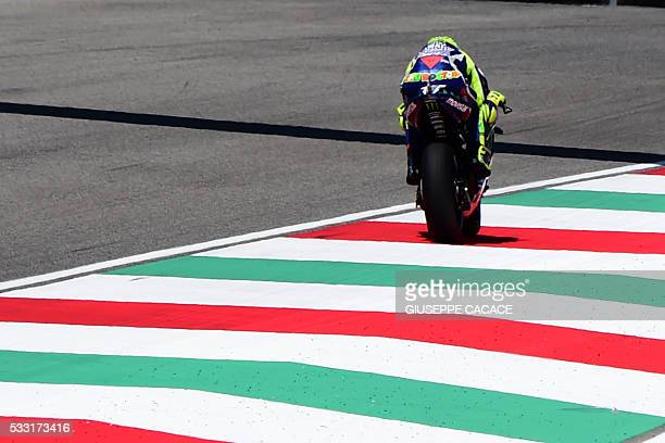 Italy's Valentino Rossi rides his Yamaha during the qualification session on the eve of the Italian MotoGP Grand Prix at the racetrack in Mugello on...