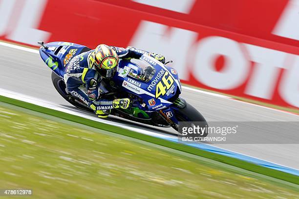 Italy's Valentino Rossi rides on his Yamaha during the MotoGP qualifying practice session ahead of theDutch Grand Prix at Assen The Netherlands on...