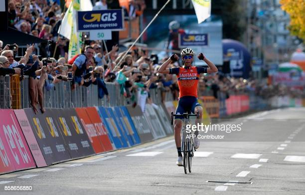 Italy's Vincenzo Nibali from the BahrainMerida team gestures as he celebrates victory while crossing the finish line of the 111th edition of The Giro...