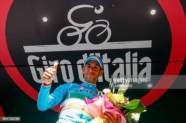 Italy's Vincenzo Nibali of team Astana celebrates on the podium after winning the 19th stage of the 99th Giro d'Italia, Tour of Italy, from Pinerolo...