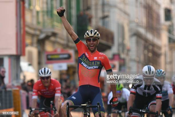 Italy's Vincenzo Nibali of team Bahrain celebrates after crossing the finish line to win the 109th edition of the Milan San Remo cycling race on...