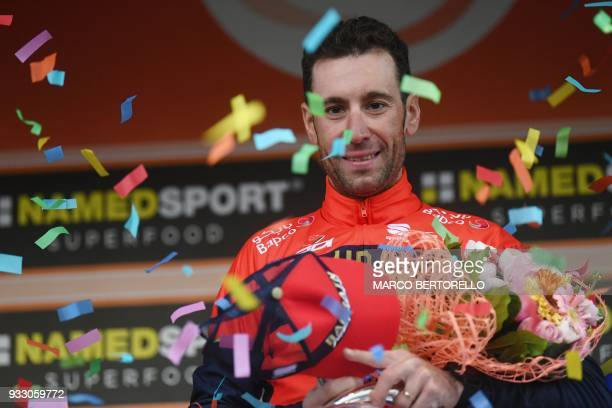 Italy's Vincenzo Nibali of team Bahrain celebrates on the podium after winning the 109th edition of the Milan San Remo cycling race on March 17 2018...