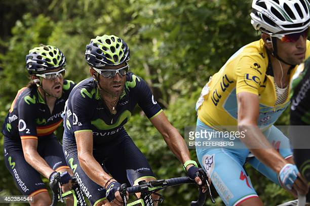 Italy's Vincenzo Nibali wearing the overall leader's yellow jersey rides in a breakaway ahead of Spain's Alejandro Valverde and Spain's Imanol Erviti...