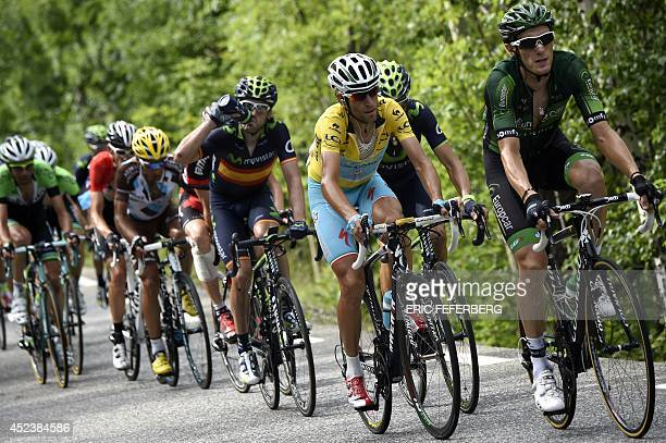 Italy's Vincenzo Nibali wearing the overall leader's yellow jersey rides in a breakaway behind France's Pierre Rolland and ahead of Spain's Alejandro...