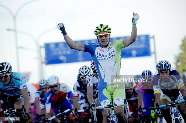 Italy's Viviani Elia of the LiquigasCannondale team celebrates as he sprints over the finish line during the first stage of the 2012 Tour of Beijing...