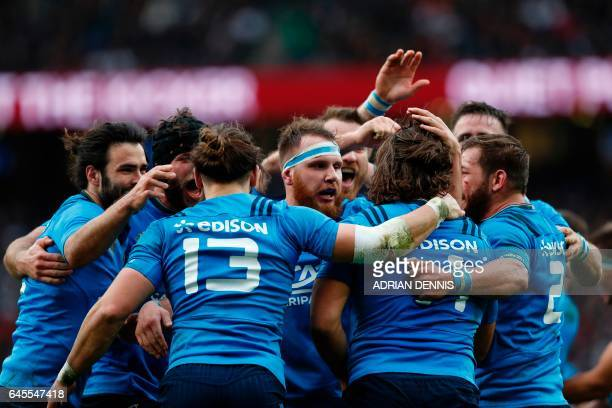 TOPSHOT Italy's wing Giovanbattista Venditti celebrates with teammates after scoring a try during the Six Nations international rugby union match...