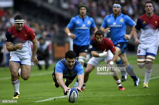 Italy's wing Leonardo Sarto jumps for the ball during the Six Nations international rugby union match between France and Italy at the Stade de France...