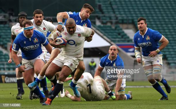 Italy's wing Luca Sperandio tackles England's prop Kyle Sinckler during the Six Nations international rugby union match between England and Italy at...