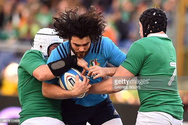 Italy's wing Luke McLean is tackled by Ireland's hooker Rory Best and Ireland's flanker Tommy ODonnell during the Six Nations International Rugby...