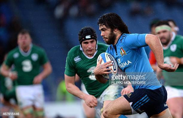 Italy's wing Luke McLean runs with the ball during the Six Nations International Rugby Union match between Italy and Ireland at the Olympic Stadium...