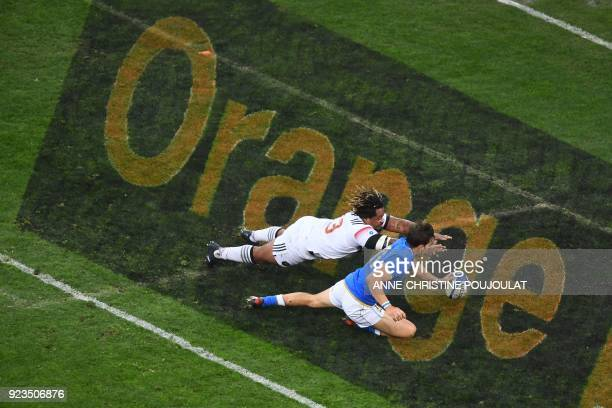 Italy's winger Mattia Bellini and France's centre Mathieu Bastareaud chase the ball over the try line during the Six Nations international rugby...