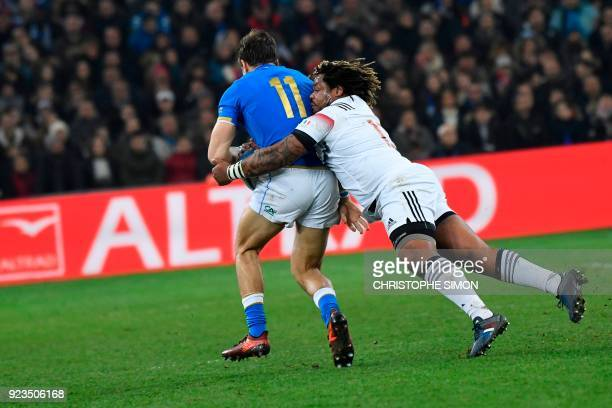 Italy's winger Mattia Bellini is tackled by France's centre Mathieu Bastareaud during the Six Nations international rugby union match between France...