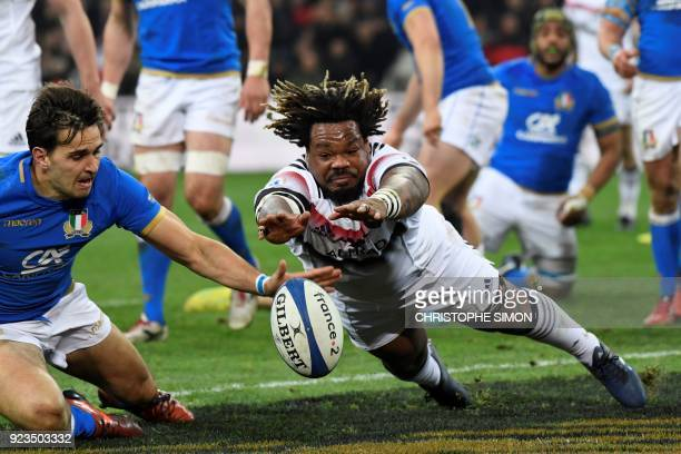 Italy's winger Mattia Bellini looks on as France's centre Mathieu Bastareaud fails to score a try during the Six Nations international rugby union...