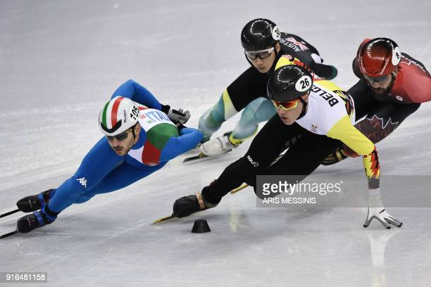 Italy's Yuri Confortola, Australia's Andy Jung, Belgium's Jens Maurits Almey and Canada's Charles Hamelin take part in the men's 1,500m short track...