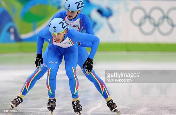 Italy's Yuri Confortola competes with compatriot Claudio Rinaldi in the men's 5000m shorttrack relay semifinal at the Pacific Coliseum in Vancouver...