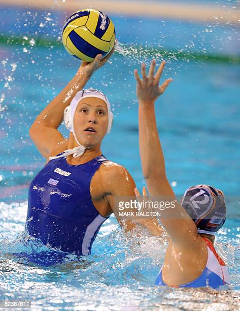 Italy'sManuela Zanchi prepares to shoot as Simone Koot from the Netherlands tries to block her during their women's quarterfinal water polo match of...