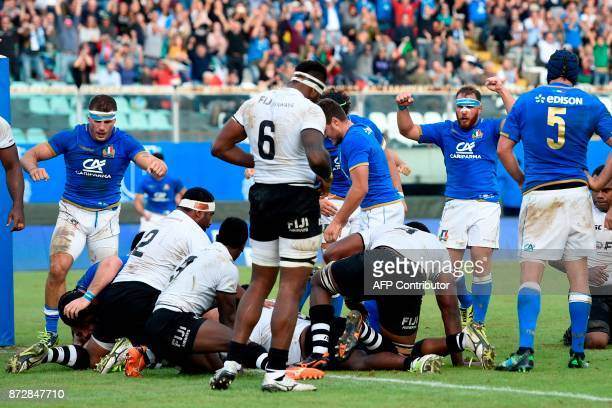 Italys's players react after a try during a rugby union test match between Italy and Fiji at the Angelo Massimino Stadium in Catania on Novemver 11...