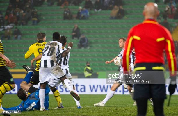 The ball comes off Udinese's Joel Ekstrand as the linesman looks on but no penalty is given