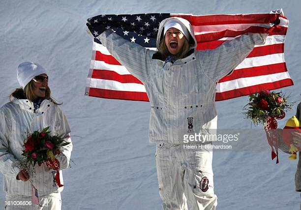 02_13_2006_BARDONECCHIA ItalyWOMENS SNOWBOARDING HALFPIPE American Hannah Teter screams with delight on the medals podium after she beat out her...