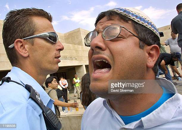 Itamar Ben Gvir an extremist rightwing Israeli activist screams antiArab slogans at the scene of an explosion in a cafeteria July 31 2002 at Hebrew...