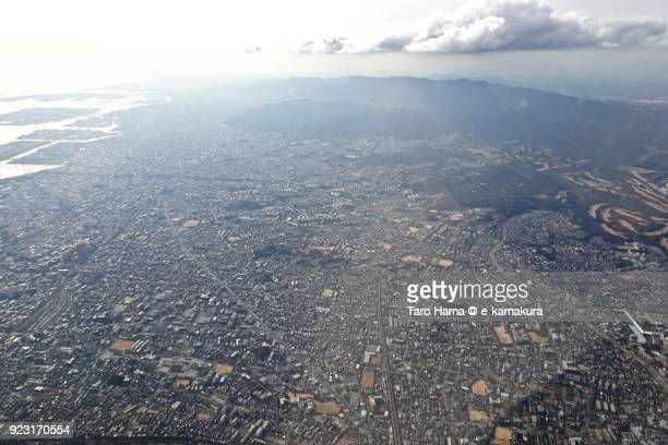 Itami city in Hyogo prefecture in Japan daytime aerial view from airplane