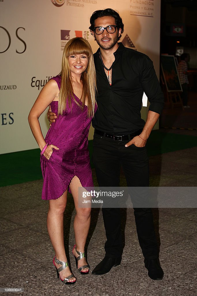 Itati Cantoral and Alejandro Maldonado pose for a photograph at the green carpet of the movie ?Oceanos? at the National Auditorium on May 19, 2010 in Mexico City, Mexico.