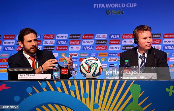 Itau Unibanco Economist Caio Megale and FIFA Head of Strategy and Brand Management Ralph Straus attend a press conference during a media day ahead of...