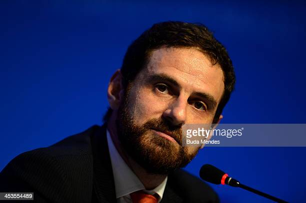 Itau Unibanco Economist Caio Megale attends a press conference during a media day ahead of the Final Draw for the 2014 FIFA World Cup at Costa do...