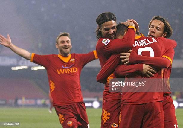 Itay, Roma's aregentinian midfielder Erik Lamela celebrates with team mates Daniele De Rossi , Pablo Osvaldo and Rodirigo Taddei after scoring during...