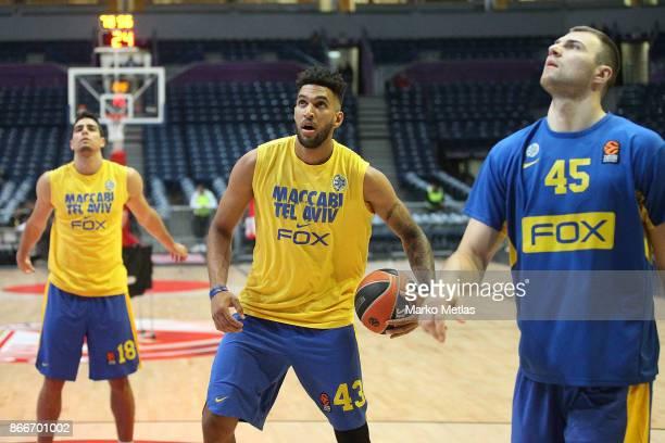 Itay Segev #18 Jonah Bolden #43 and Artsiom Parakhouski #45 of Maccabi Fox Tel Aviv warm up during the 2017/2018 Turkish Airlines EuroLeague Regular...
