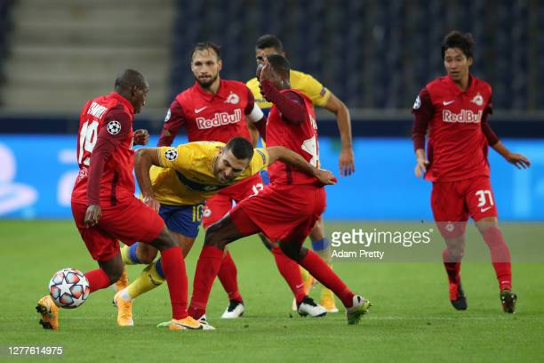 Itay Shechter of Maccabi TelAviv is challenged by Mohamed Kamara and Enock Mwepu of RB Salzburg during the UEFA Champions League PlayOff second leg...