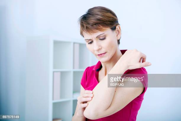 itching in a woman - eczema stock pictures, royalty-free photos & images