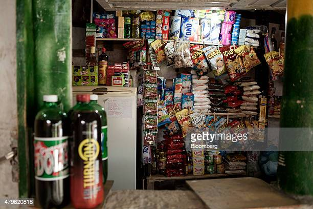 Items are displayed for sale at a store in the Dilma Rousseff favela of Rio de Janeiro Brazil on Monday July 6 2015 As the fastest inflation in more...