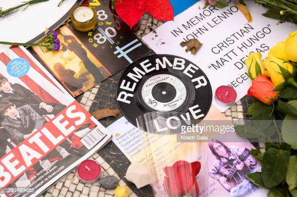 "Items are left on the ""Imagine"" memorial in honor of John Lennon on the 40th anniversary of his death at Strawberry Fields in Central Park on..."